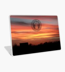 Barn Silhouette on a Layered Sunset Laptop Skin