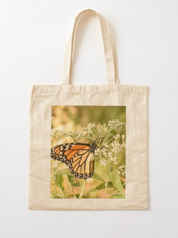 Alternate view of Monarch butterfly on white flowers Tote Bag