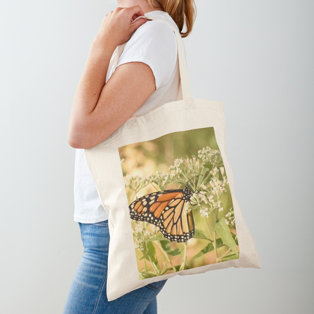 Monarch butterfly on white flowers Tote Bag