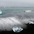 Chards of ice on the beach - Iceland by Kathy White