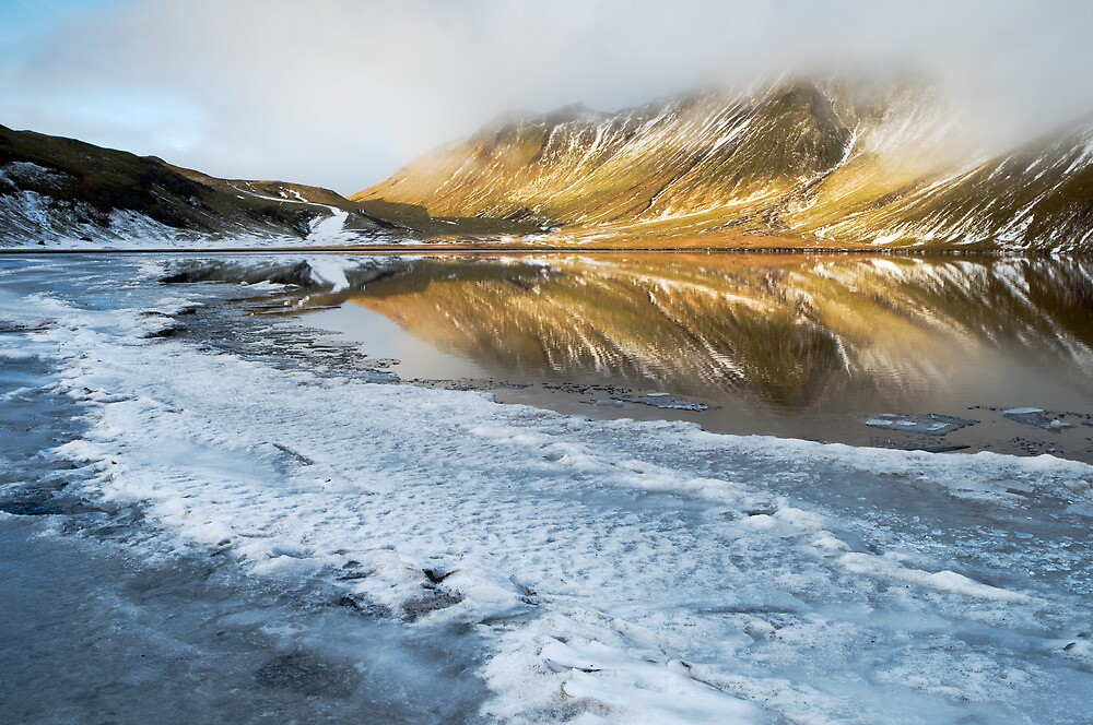 Reflections on a frozen lake - Iceland by Kathy White