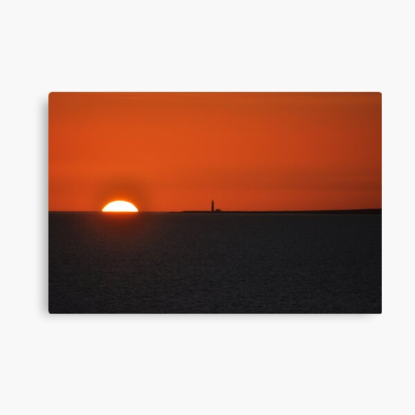 Sunset with lighthouse on Atlantic Canvas Print