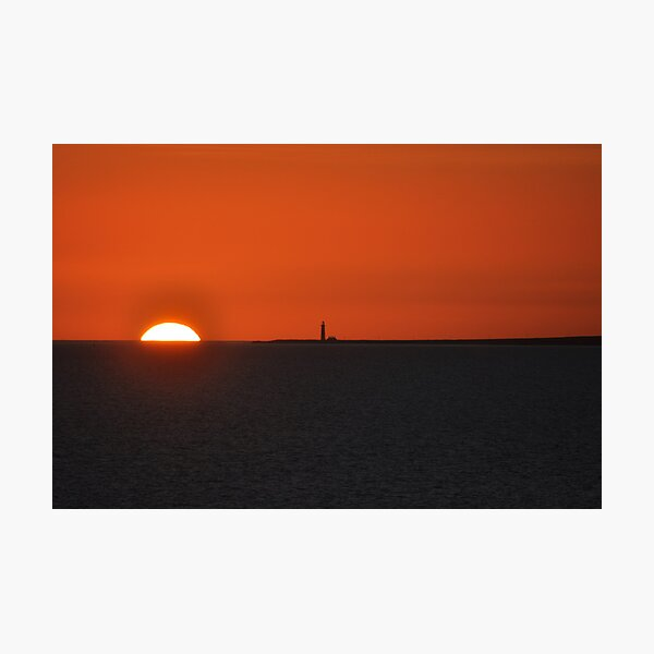 Sunset with lighthouse on Atlantic Photographic Print