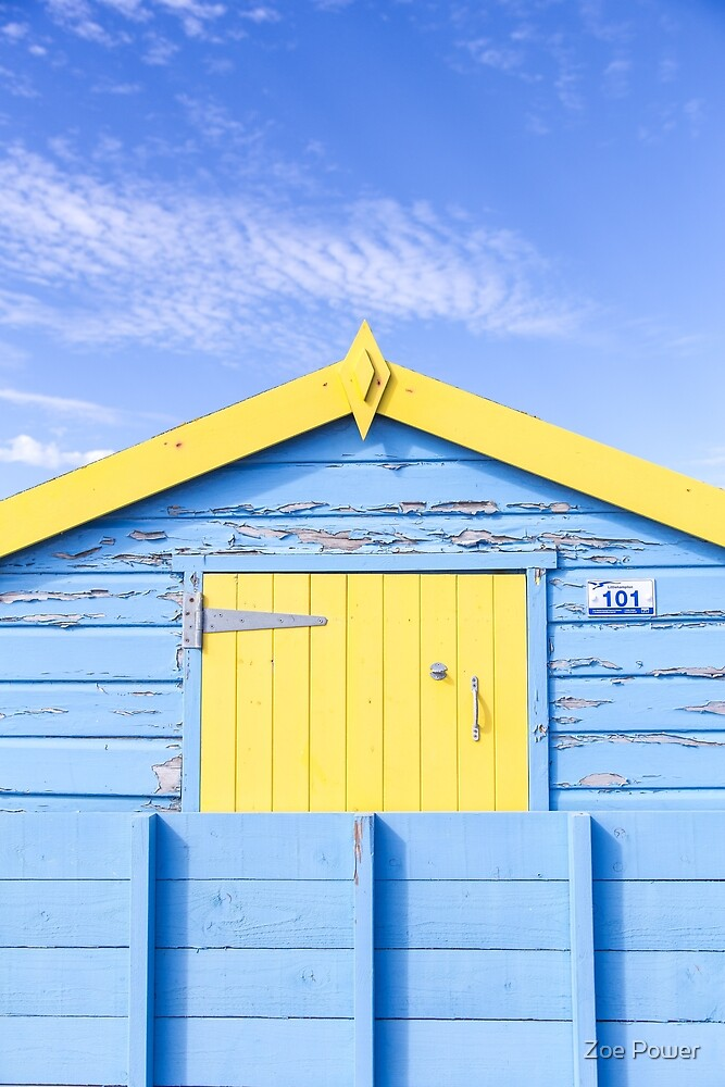 Pretty pastel blue and yellow beach hut by Zoe Power