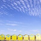 Yellow beach huts and blue skies at Littlehampton beach by Zoe Power