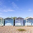 Pastel blue stripey beach huts, West Sussex by Zoe Power