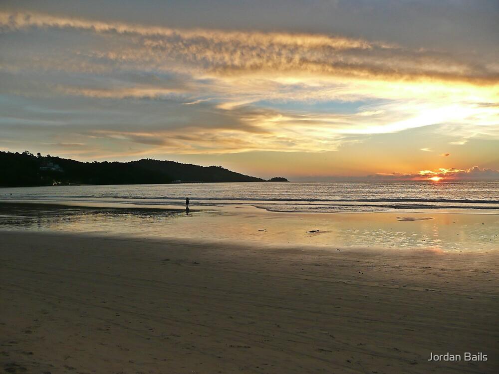 Destruction to Paradise - a sunset at a Phuket beach by Jordan Bails