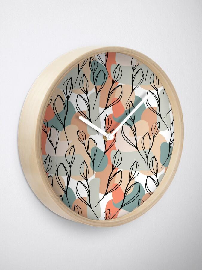 Alternative Ansicht von Schwarzblätter und Pastellhintergrund Uhr
