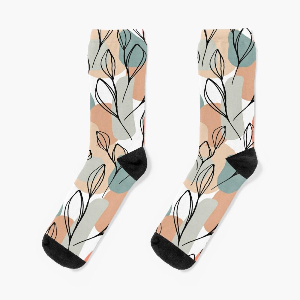 Schwarzblätter und Pastellhintergrund Socken