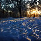 Sun setting over snow by KathO
