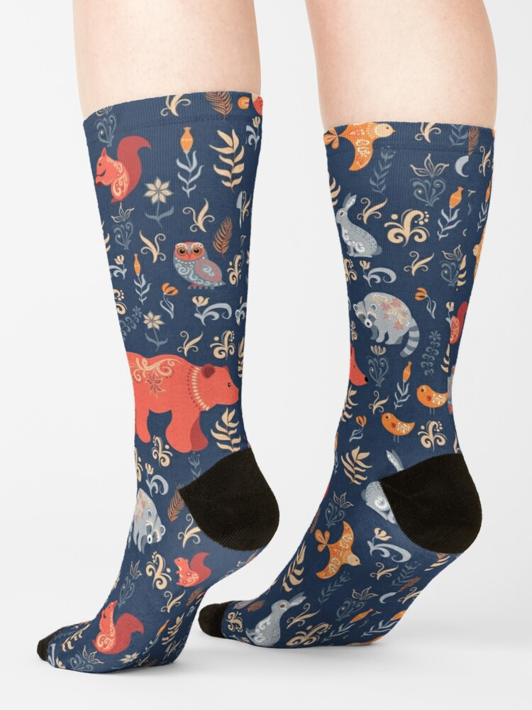 Alternate view of Fairy-tale forest. Fox, bear, raccoon, owls, rabbits, flowers and herbs on a blue background. Socks