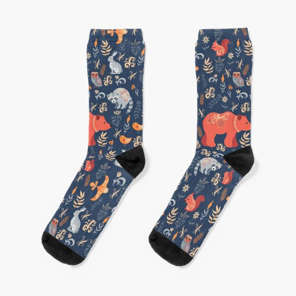 Fairy-tale forest. Fox, bear, raccoon, owls, rabbits, flowers and herbs on a blue background. Socks