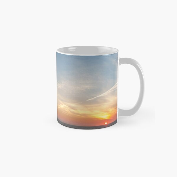 photograph a man on a huge chair at sunset in Îles-de-la-Madeleine Classic Mug