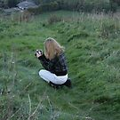 little girl taking a photograph by Profo Folia