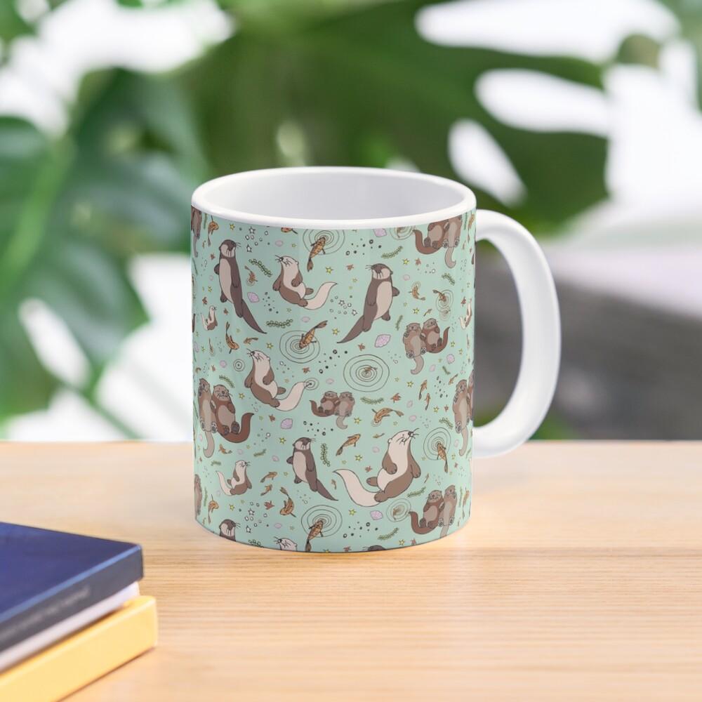 Otters in Blue Mug