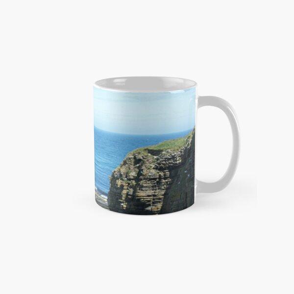 Rocks and raised ledge in sea Classic Mug