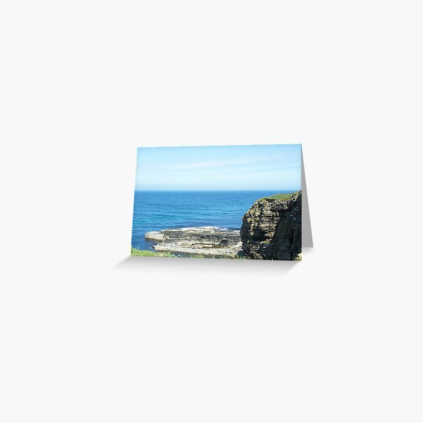 Rocks and raised ledge in sea Greeting Card