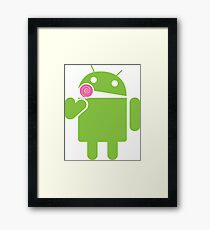Android eats a lollipop Framed Print