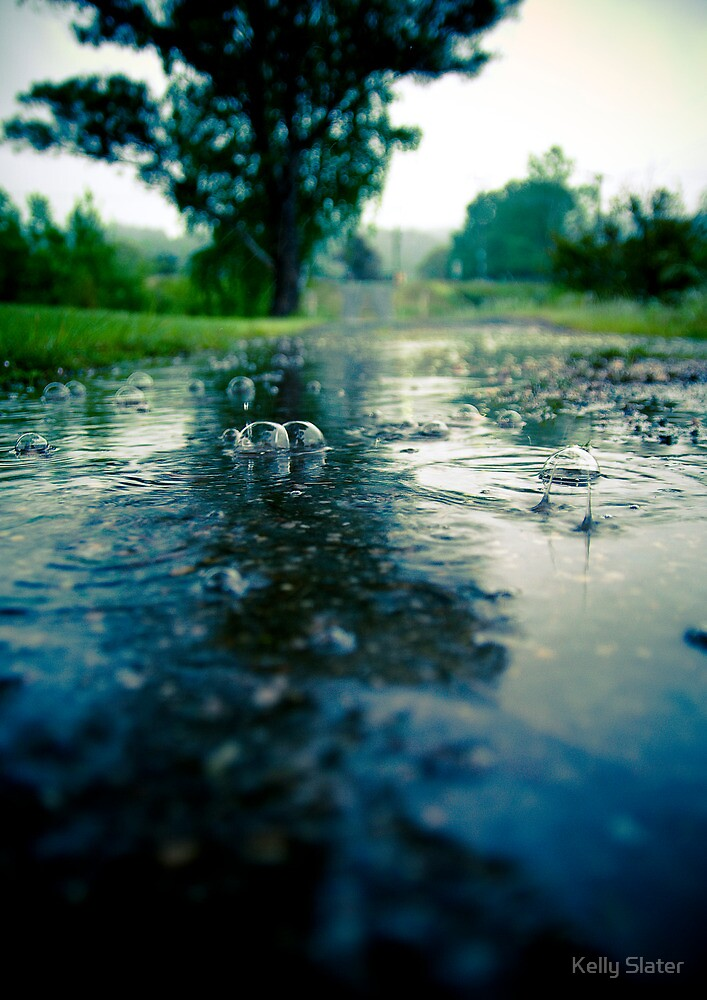 Puddle bubbles by Kelly Slater