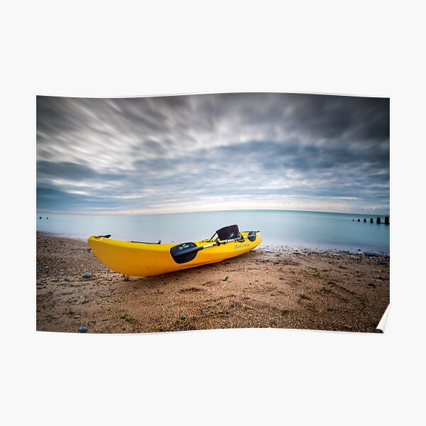 Kayak on the beach Poster