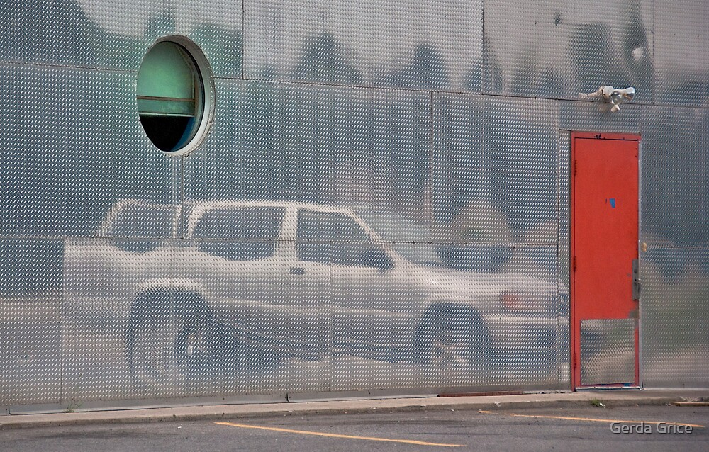 Car in Semi-Transparent Enclosure with Green Circular Opening and Red Door by Gerda Grice
