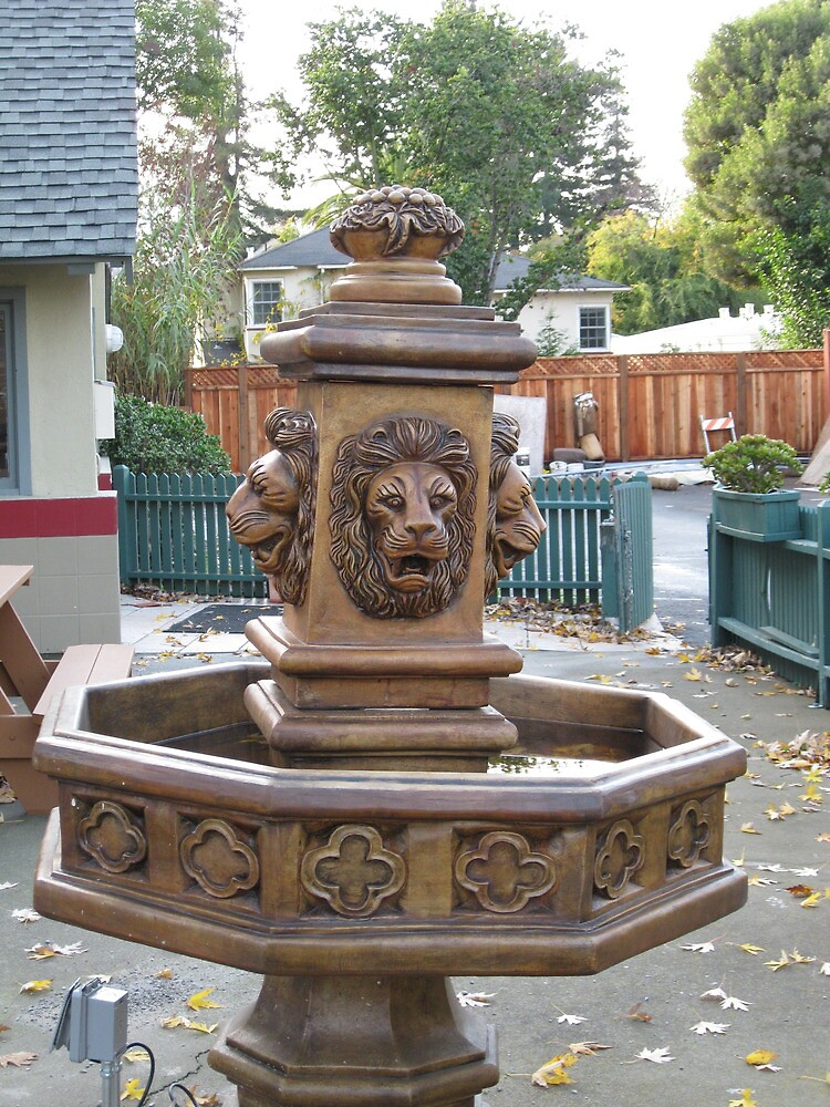 a brass fountain  by kevin seraphin