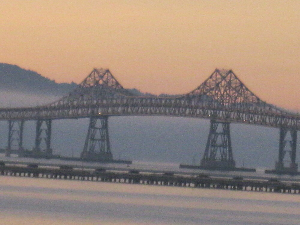 San Rafael bridge in the sky at sunset by kevin seraphin
