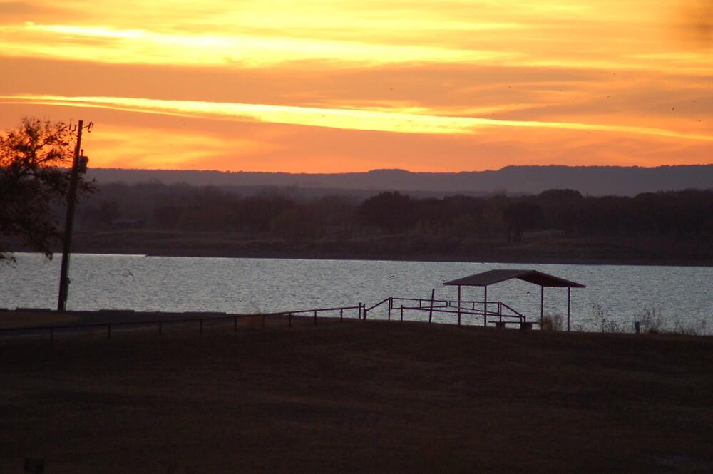 sunset at the lake by neldia