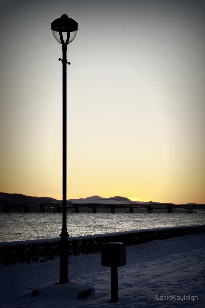 Lamp silhouette as the sun has set on a snowy day by CasioKayleigh