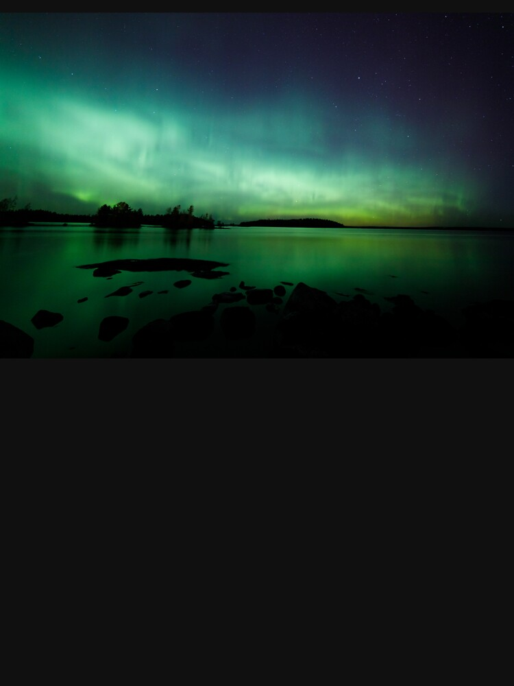 Beautiful northern lights over lake by Juhku