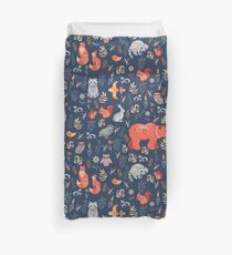 Fairy-tale forest. Fox, bear, raccoon, owls, rabbits, flowers and herbs on a blue background. Duvet Cover