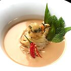 Fragrant Almond Laksa with noodles, fresh herbs and Oriental garden crispy prawns by RecipeTaster