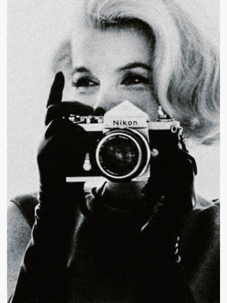 Marilyn Monroe with her Camera by Angelacassiani