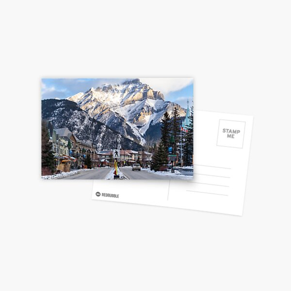 View of downtown Banff National Park, a Unesco World Heritage Site, during the winter. Cascade Mountain in background Postcard