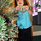 Vaida Decorating The Christmas Tree by Wanda Raines