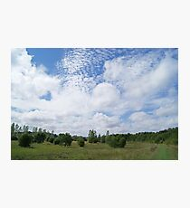 Rolling clouds over plains Photographic Print