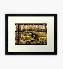 landscape with the ladder Framed Print