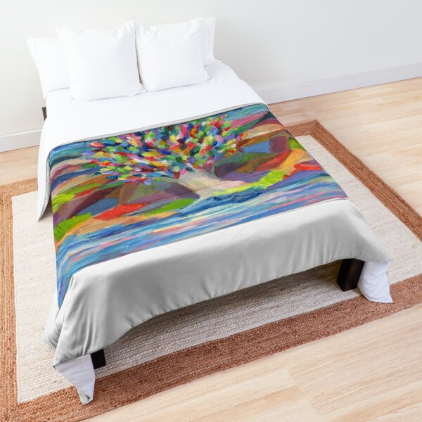 Dream Tree, grow your hopes and dreams. A rainbow leaved tree grows on a rocky coast by the sea in this colorful acrylic daydream. Comforter
