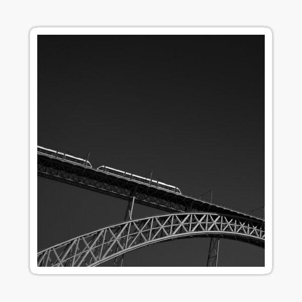 A metro riding across the Douro river on the Dom Luís I Bridge, in Porto, Portugal Sticker