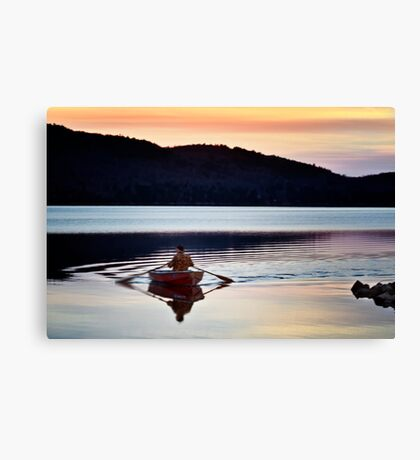 Rowing the lake Canvas Print