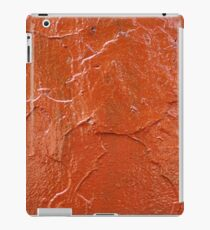 Thick and uneven layer of red paint on a wall closeup iPad Case/Skin
