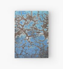 Blue cracked paint on pavement - 2015 Hardcover Journal