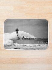 Lighthouse in a storm Bath Mat