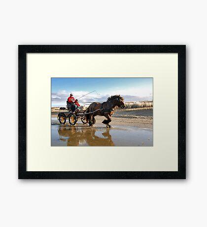 A beach ride Framed Print