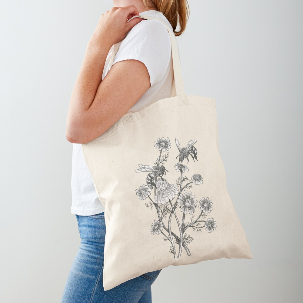 bees and chamomile on honey background  Tote Bag