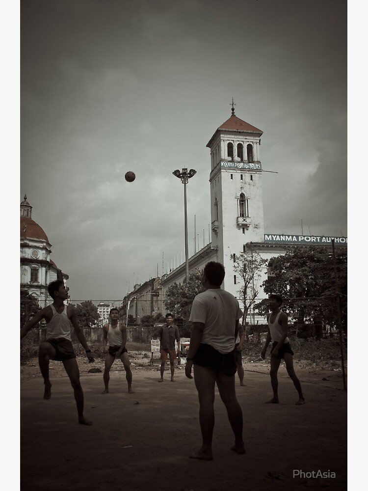 Playing chinlone in Yangon  by PhotAsia
