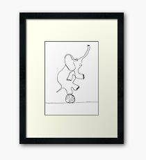 elephant on ball Framed Print