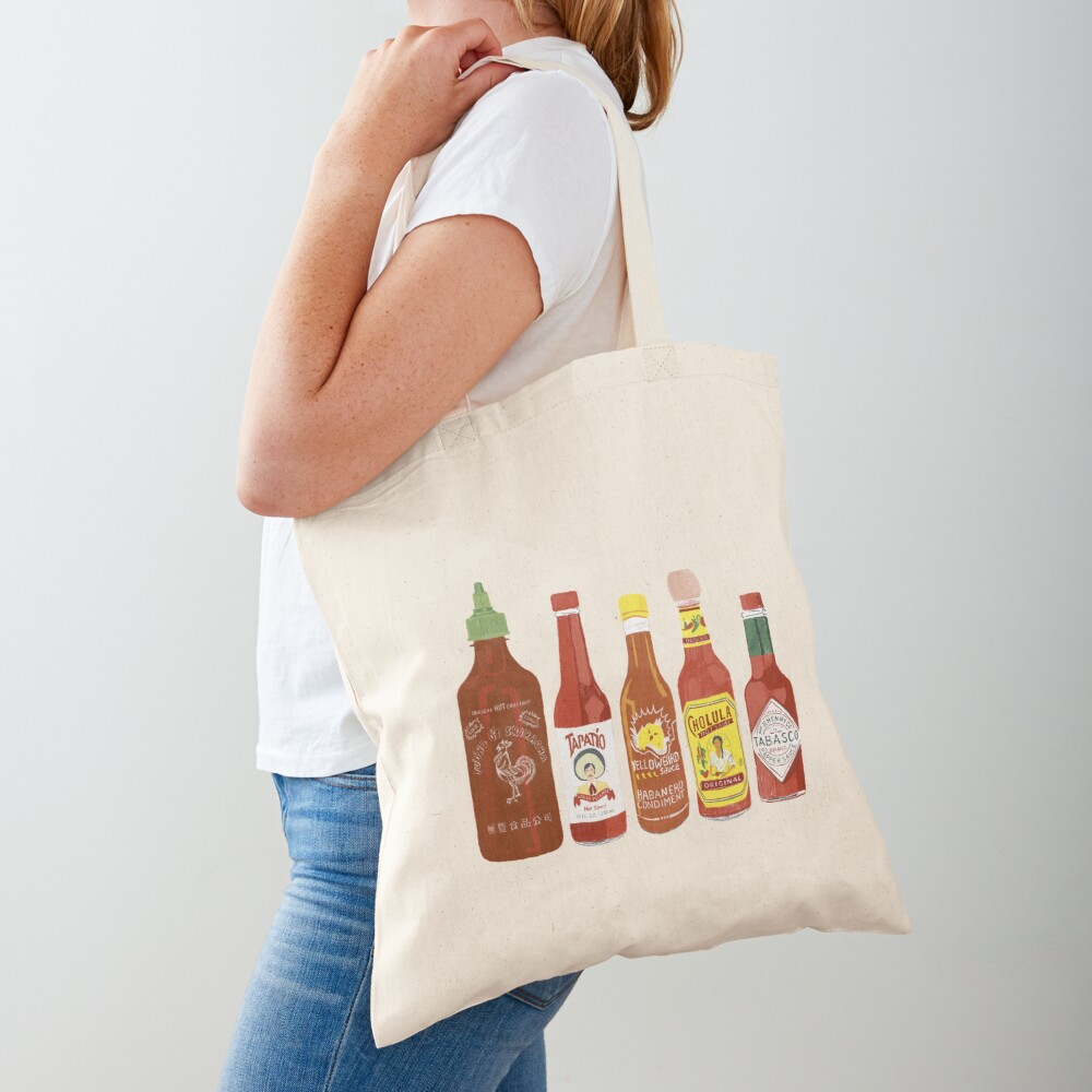 Spicy! Check out these hot sauces on black background Tote Bag