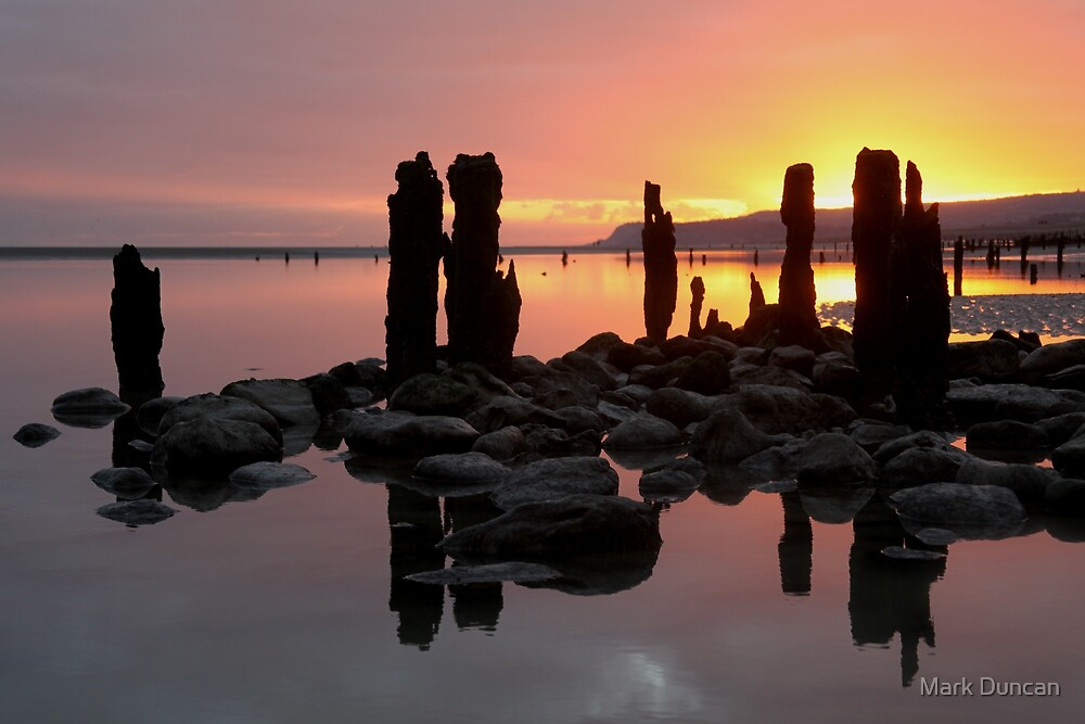 Winchelse Beach - Low Tide Posts in the Sunset by Mark Duncan