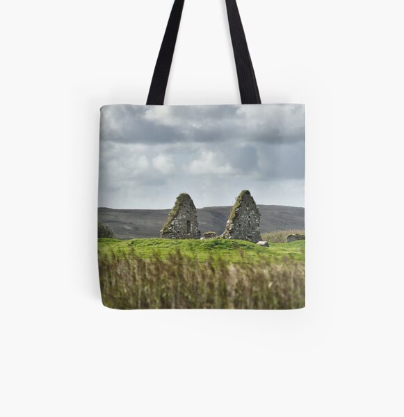 The ruins of Finlaggan seen of the reeds of Loch Finlaggan - Islay All Over Print Tote Bag